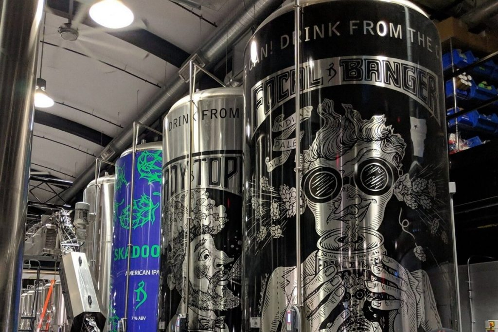 Heady topper cans shown to represent beer stocks, beer Industry and alcohol stocks