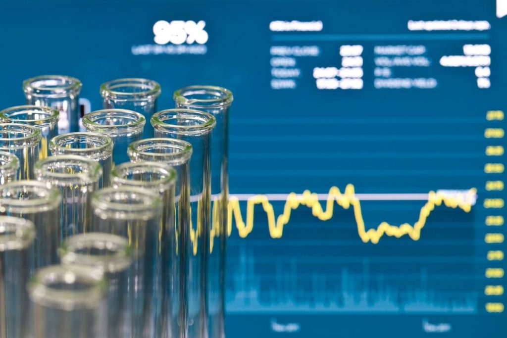 Test tubes over financial data