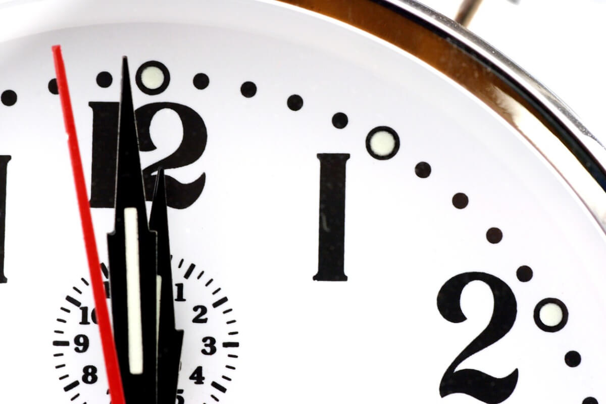 Detail of a clock counting down, with only a few seconds to go till midnight