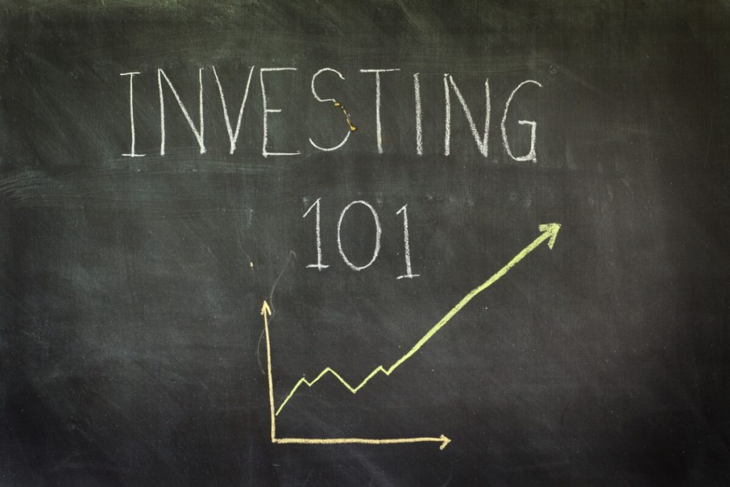 investing 101 written on chalk board - investing in monopolies