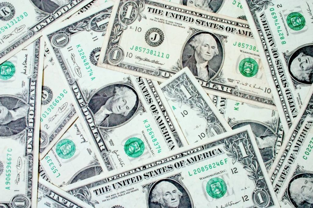 Dollar Bills - Fintech stocks and How to Reinvest Dividends 4 Stocks to Own for a Weakening Dollar
