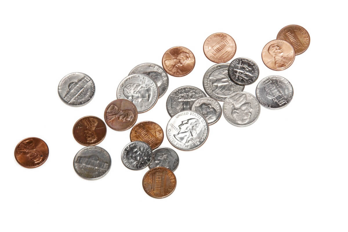 Handful of pocket change is isolated on a white background