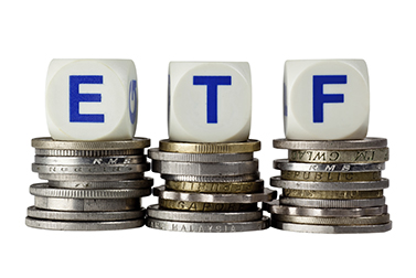Stacks of coins with the letters ETF isolated on white background