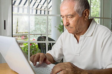 senior man looking for information and learning on the internet