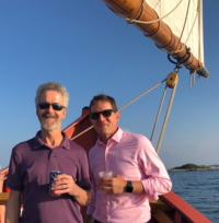 Left to right: Timothy Lutts and Ed Coburn sailing in Salem harbor.